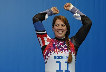 Third-placed Erin Hamlin of the U.S. celebrates after the women's singles luge event at the 2014 Sochi Winter Olympics, at the Sanki Sliding