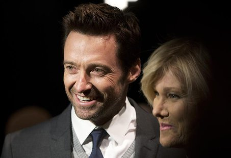 Actor Hugh Jackman (L) and wife Deborra-Lee Furness arrive for the Donna Karan New York show during New York Fashion Week February 10, 2014.
