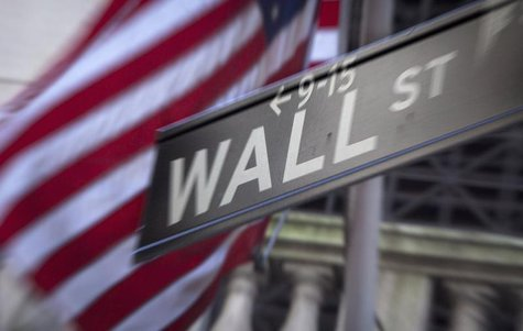 A Wall Street sign is pictured outside the New York Stock Exchange in New York, October 28, 2013. REUTERS/Carlo Allegri