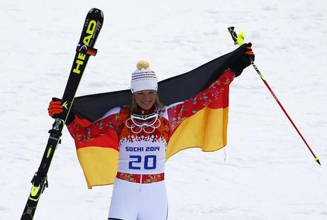 Germany's Maria Hoefl-Riesch celebrates winning the women's alpine skiing super combined event at the 2014 Sochi Winter Olympics at the Rosa