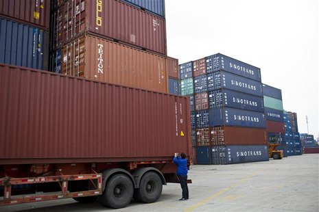 An employee takes notes at a port of Shanghai Free Trade Zone, February 11, 2014. REUTERS/Aly Song )