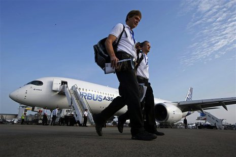 Visitors walk past an Airbus A350 on display at the Singapore Airshow February 12, 2014. REUTERS/Edgar Su