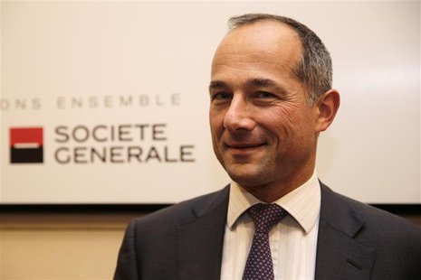 French bank Societe Generale Chairman and Chief Executive Officer Frederic Oudea poses after the company's 2013 annual results presentation