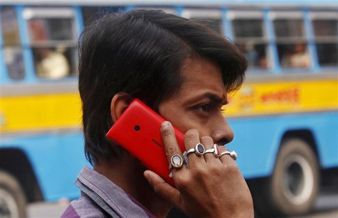 A man uses a Nokia mobile phone to make a call on a street in Kolkata December 12, 2013. REUTERS/Rupak De Chowdhuri