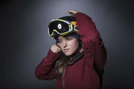 Olympic snowboarder Arielle Gold mimics her pre-run preparation during the 2013 U.S. Olympic Team Media Summit in Park City, Utah October 2,