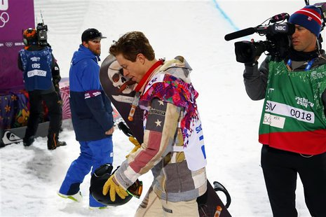 Shaun White of the U.S. walks away after failing to win a medal in the men's snowboard halfpipe qualification round at the 2014 Sochi Winter