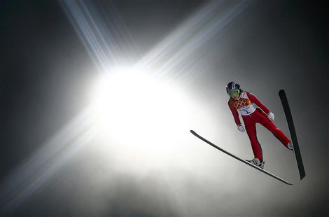 Sarah Hendrickson of the U.S. soars through the air in her trial jump during the women's ski jumping individual normal hill event of the Soc