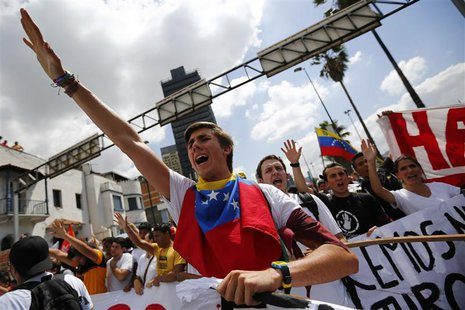 Opposition supporters demonstrate against Venezuela's President Nicolas Maduro's government in Caracas February 12, 2014. REUTERS/Jorge Silv
