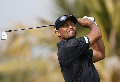 Tiger Woods of the U.S. tees off on the fourth hole during the second round of the 2014 Omega Dubai Desert Classic in Dubai January 31, 2014