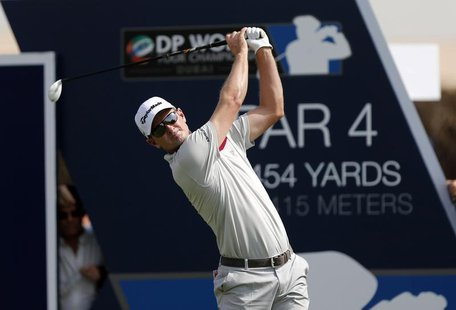 Justin Rose of England tees off on the first hole during the first round of the DP World Tour Championship golf tournament in Dubai November
