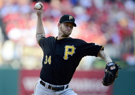 Oct 3, 2013; St. Louis, MO, USA; Pittsburgh Pirates starting pitcher A.J. Burnett (34) throws to a St. Louis Cardinals batter during the fir