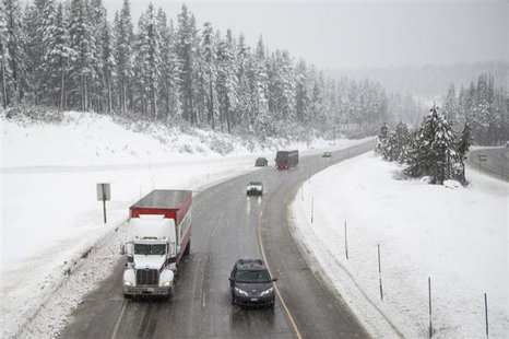 Traffic makes it way slowly up Interstate 80 near Donner Pass in Soda Springs, California, February 8, 2014. CREDIT: REUTERS/MAX WHITTAKER