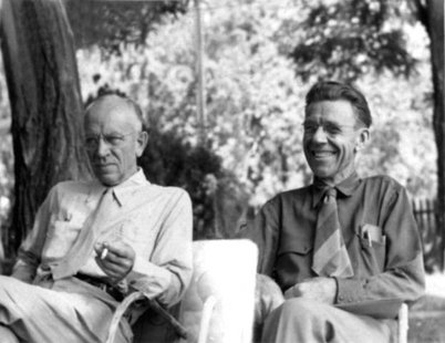 Aldo Leopold (left) and Olaus Muire sitting together outdoors, annual meeting of The Wilderness Society Council, Old Rag, Virginia, 1946.  By Howard Zahniser (NCTC Archives/Museum) [Public domain], via Wikimedia Commons
