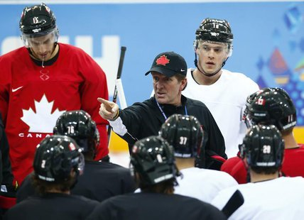 Canada's head coach Mike Babcock directs his team during their men's team ice hockey practice at the 2014 Sochi Winter Olympics, February 12