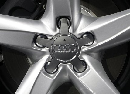 The company logo of Volkswagen's Audi AG premium unit is pictured on the hub caps of a car during the annual news conference in Ingolstadt M