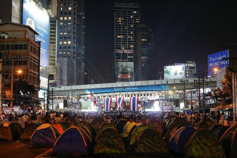Anti-government protesters camp near a stage as they occupy a main intersection in central Bangkok February 5, 2014. REUTERS/Athit Perawongm