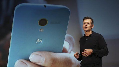 Motorola Mobility Chief Executive Dennis Woodside talks during the worldwide presentation of the Moto G mobile phone in Sao Paulo November 1