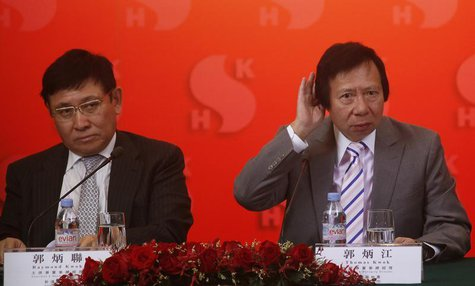 Chairmen of Hong Kong developer Sun Hung Kai Properties Raymond Kwok (L) and Thomas Kwok listen to questions during a news conference in Hon