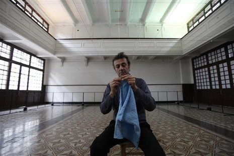 "Artist Kutlug Ataman attaches the first cloth to start his art project ""Silsel"" at Galata Greek Primary School in Istanbul in this May 12, 2"