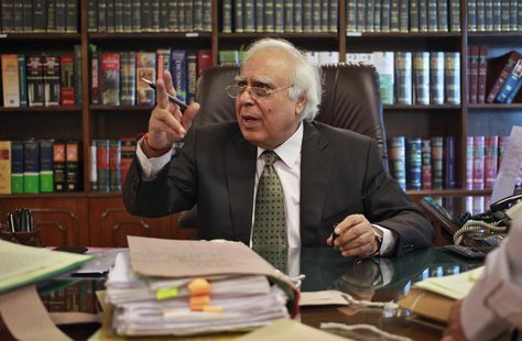 India's Telecommunications Minister Kapil Sibal gestures after an interview with Reuters at his office in New Delhi October 15, 2013. REUTER