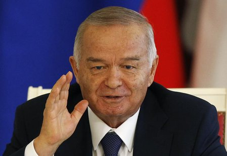Uzbekistan's President Islam Karimov gestures during a signing ceremony after talks with his Russian counterpart Vladimir Putin at the Kreml