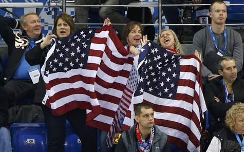 Team USA fans celebrate during the USA versus Slovakia men's preliminary round ice hockey game at the 2014 Sochi Winter Olympics, February 1