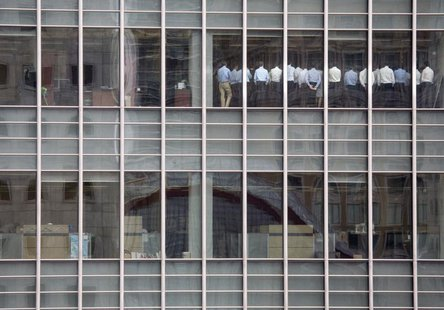 Staff stand in a meeting room at Lehman Brothers offices in the financial district of Canary Wharf in London September 11, 2008. REUTERS/Kev