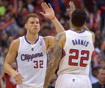 Los Angeles Clippers forwards Blake Griffin (32) and Matt Barnes (22) exchange high fives in the fourth quarter against the Portland Trail B