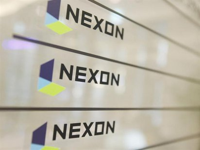 Logos of online gaming firm Nexon are seen at its main office building in Seoul December 14, 2011. REUTERS/Kim Hong-Ji