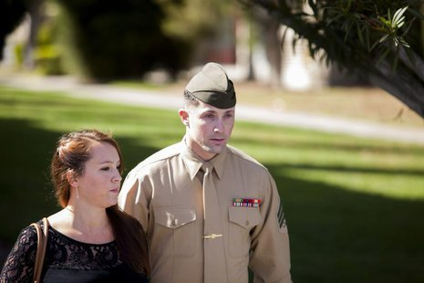 United States Marine Sergeant Lawrence Hutchins III departs from his arraignment hearing with his wife Reyna Hutchins at Camp Pendelton, Cal
