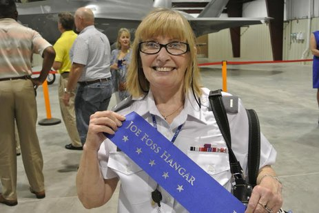 First Lieutenant Janet Watson, Historian, CAP's Yuma Composite Squadron 508 of the Arizona Wing holds a banner dedicating hangar to Joe Foss. (Photo Courtesy C.A.P.)
