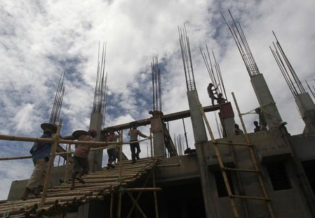 Labourers work at the construction site of a commercial complex in Agartala, capital of India's northeastern Indian state of Tripura August
