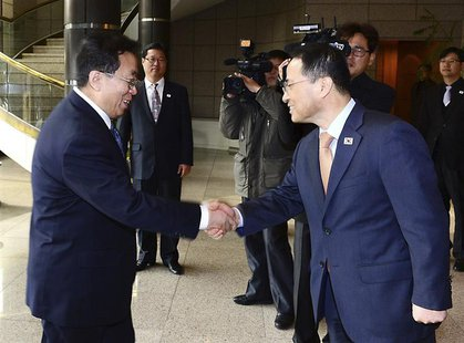 Head of the North Korean high-level delegation, Won Tong Yon (L) shakes hands with his South Korean counterpart Kim Kyou-hyun upon his arriv