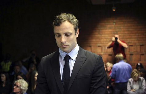Olympic and Paralympic running star Oscar Pistorius stands during court proceedings at the Pretoria Magistrates court August 19, 2013. REUTE