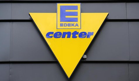 The logo of German supermarket chain Edeka is pictured out side a store in Berlin, May 29, 2013. REUTERS/Fabrizio Bensch