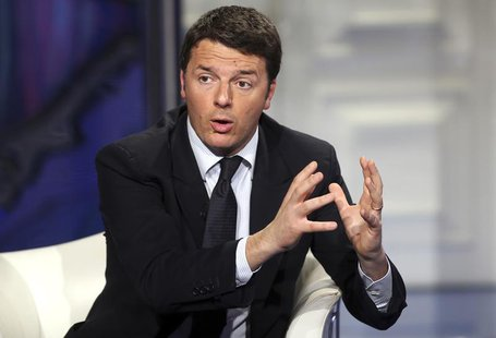 Italy's center-left Democratic Party (PD) leader Matteo Renzi gestures as he appears as a guest on the RAI television show Porta a Porta (Do