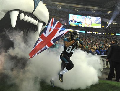 Jacksonville Jaguars wide receiver Cecil Shorts carries Britain's Union Jack as he enters the field before the Jaguars met the San Francisco