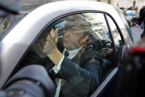 Center-left leader Matteo Renzi drives as he leaves at the end of a meeting with Italian Prime Minister Enrico Letta in Rome February 12, 20