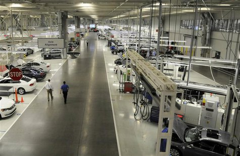 Two Volkswagen employees walk through the axle alignment department at the VW plant in Chattanooga, Tennessee in this December 1, 2011 file