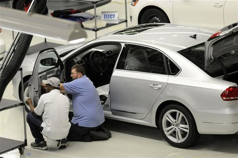 Volkswagen employees inspect a VW 2012 Passat in the assembly finish department in Chattanooga Tennessee in this December 1, 2011 file photo