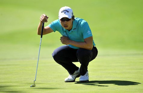 Sang-Moon Bae lines up his putt on the eighteenth hole green during the second round of the Northern Trust Open at Riviera Country Club. Man