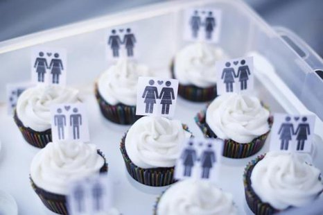 A box of cupcakes are seen topped with icons of same-sex couples at City Hall in San Francisco, June 29, 2013. CREDIT: REUTERS/STEPHEN LAM