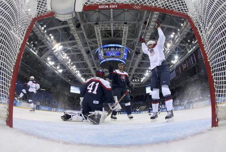 Team USA's John Carlson (L) celebrates his goal on Slovakia's goalie Jaroslav Halak (41) as Team USA's James van Riemsdyk (R) reacts during the first period of their men's preliminary round ice hockey More... Credit: REUTERS/Martin Rose/Pool