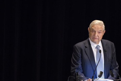 George Soros speaks on stage at the Annual Freedom Award Benefit Event hosted by the International Rescue Committee at the Waldorf-Astoria i