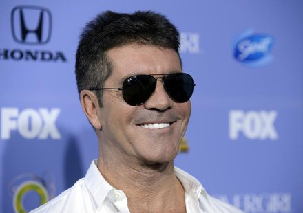 "Judge Simon Cowell attends ""The X Factor"" season three premiere event in West Hollywood, California September 5, 2013. REUTERS/Phil McCarten"