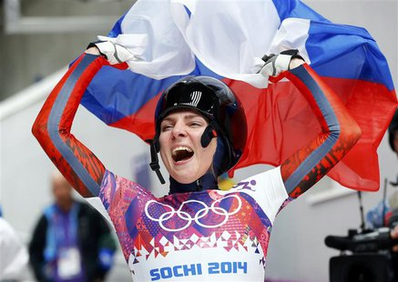 Russia's Elena Nikitina celebrates after competing in the women's skeleton event at the 2014 Sochi Winter Olympics February 14, 2014. REUTER