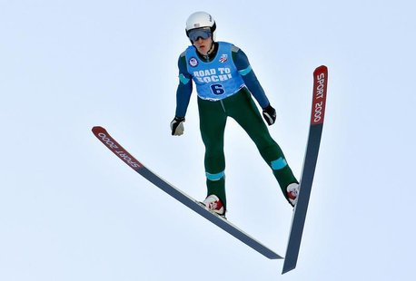 Dec 29, 2013; Park City, UT, USA; Nicholas Fairall of the United States is airborne during his ski jump during the U.S. Olympic Trials at th