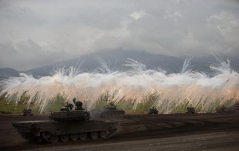 Japanese Ground Self-Defense Force armoured tanks fire during an annual training session near Mount Fuji at Higashifuji training field in Go