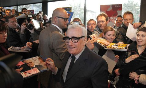 "Director Martin Scorsese signs autographs as he arrives on the red carpet before the screening of ""Untitled New York Review of Books Documen"