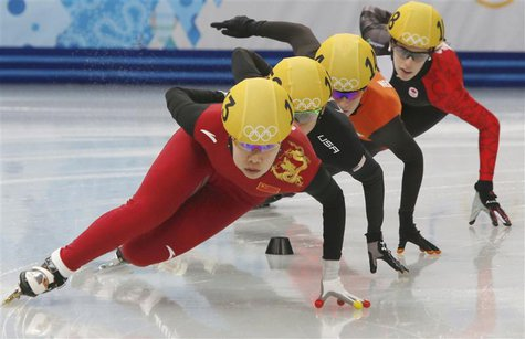 China's Zhou Yang leads as she takes a curve during a women's 1,500 metres short track speed skating heat event at the Iceberg Skating Palac